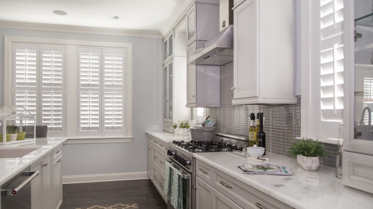 White shutters in St. George kitchen with marble counter.