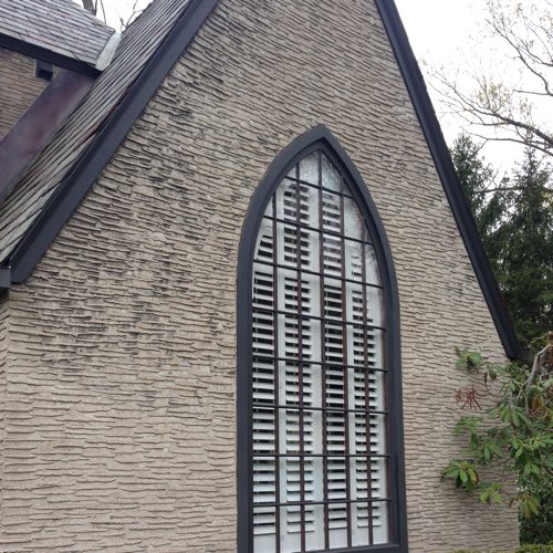outside facade of brick home with plantation shutters
