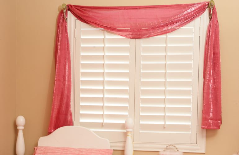Child's room with plantation shutters.