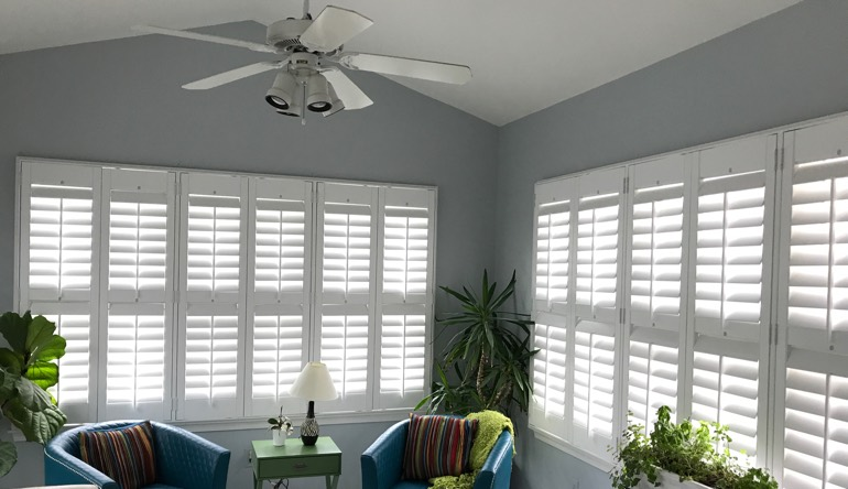 St. George living room with fan and shutters