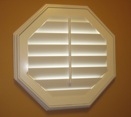 St. George octagon window with white shutter