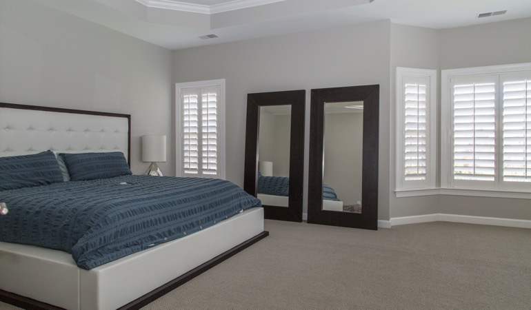 Polywood shutters in a minimalist bedroom in St. George.