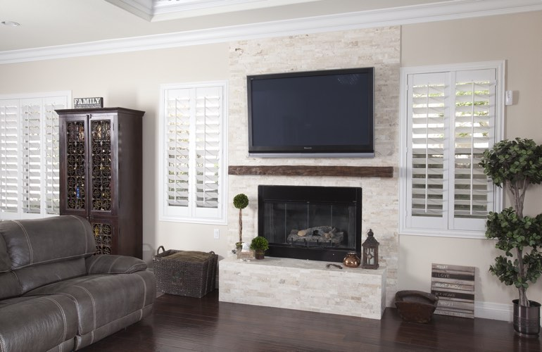 White plantation shutters in a St. George living room with solid hardwood floors.