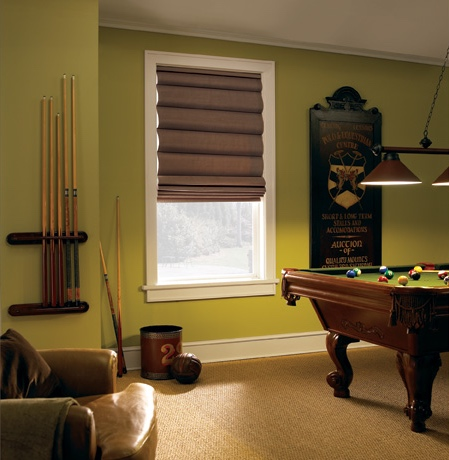 Roman shades in St. George pool room with green walls.