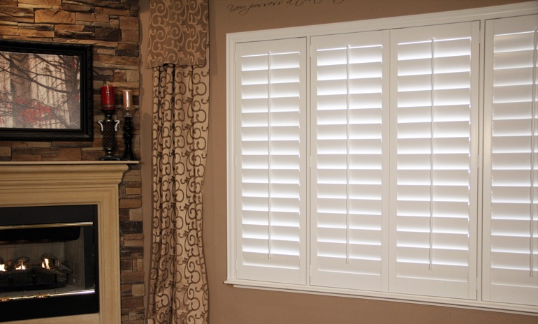 St. George Studio plantation shutters in family room.