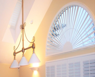 St. George arched eyebrow window with custom shutter