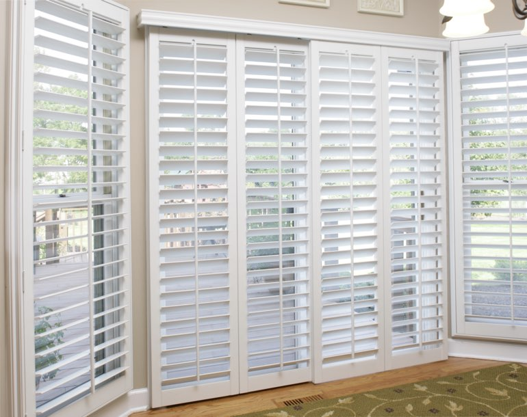 Sliding glass door with white shutters St. George