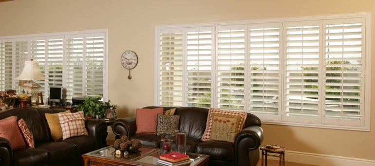 Wide window with interior shutters in St. George living room
